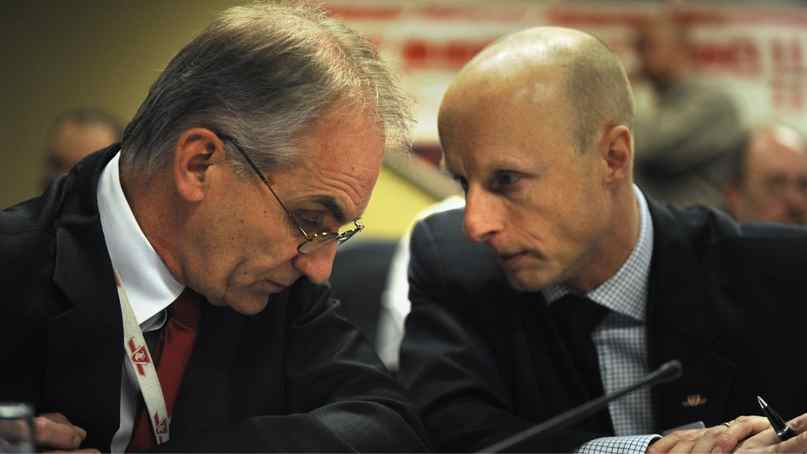 Gary Webster,left, prior to the start of a special meeting Tuesday at Toronto city Hall, to discuss his future as head of the TTC. Andy Byford, right, replaced him.