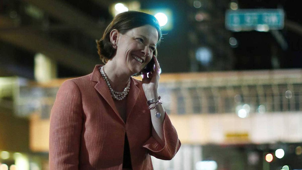 PC Alberta leader Alison Redford talks on the phone while walking back to her hotel after she won the provincial election in Calgary, Alberta, April 23, 2012. Redford and the PC party defeated the Wildrose party to continue their 40 year legacy of holding power in Alberta.