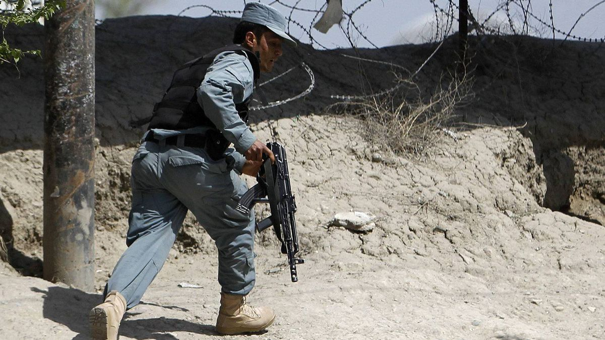 An Afghan police officer amid multiple attacks in Kabul April 15, 2012.