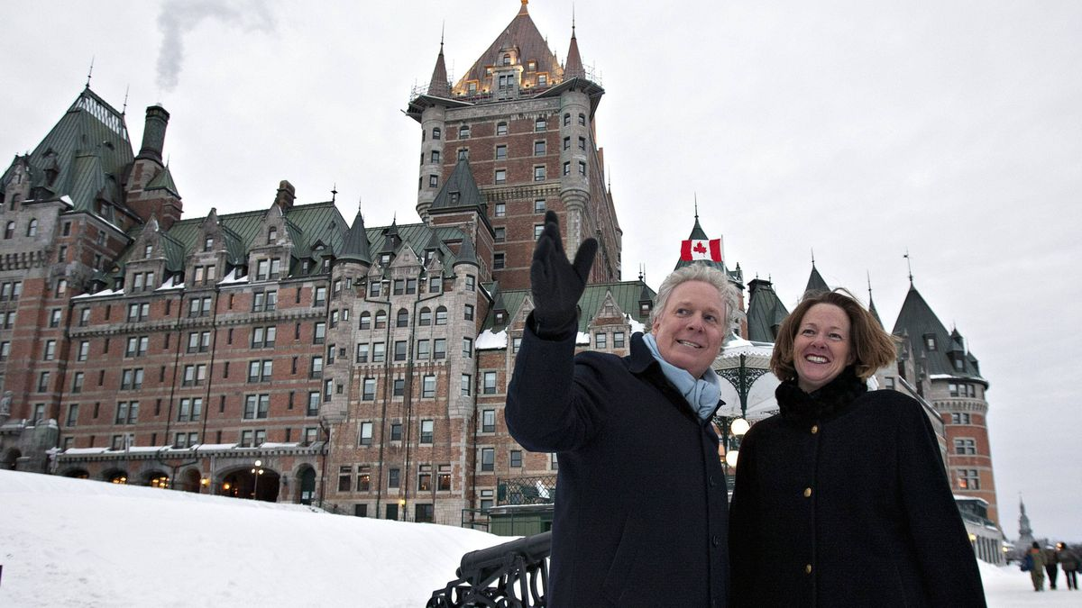 Quebec Premier Jean Charest and Alberta Premier Alison Redford pass by Quebec City's Chateau Frontenac after a meeting on Wednesday.
