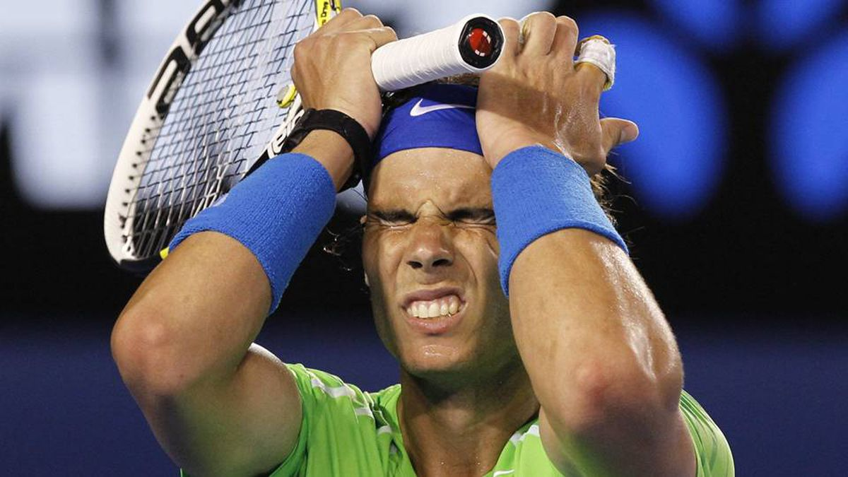 Rafael Nadal of Spain reacts during his men's singles final match against Novak Djokovic of Serbia at the Australian Open tennis tournament in Melbourne.