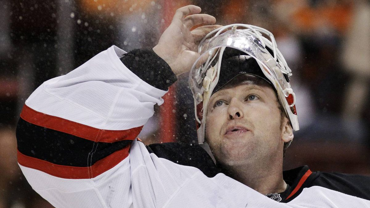 New Jersey Devils goalie Martin Brodeur blows water into the air before the second period of Game 5 of a second-round NHL hockey Stanley Cup playoff series against the Philadelphia Flyers, Tuesday, May 8, 2012, in Philadelphia. (AP Photo/Matt Slocum)