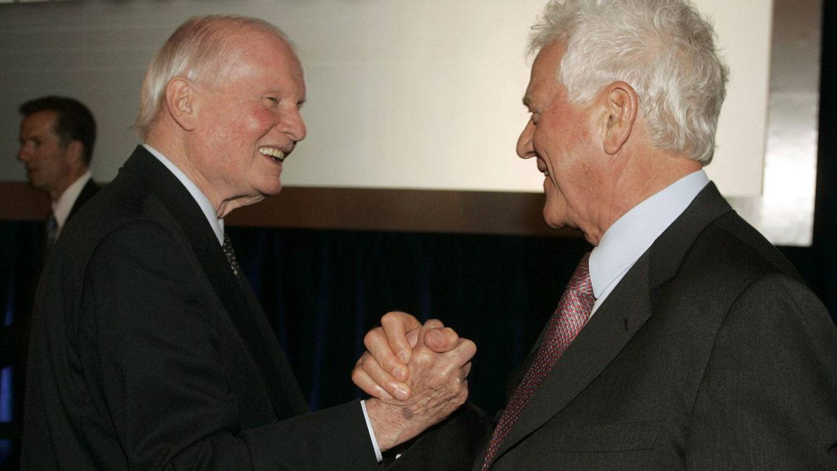 Frank Stronach (right) shakes hands with former Ontario Premier Bill Davis at the end of Magna's annual general meeting of shareholders in Toronto in 2009.
