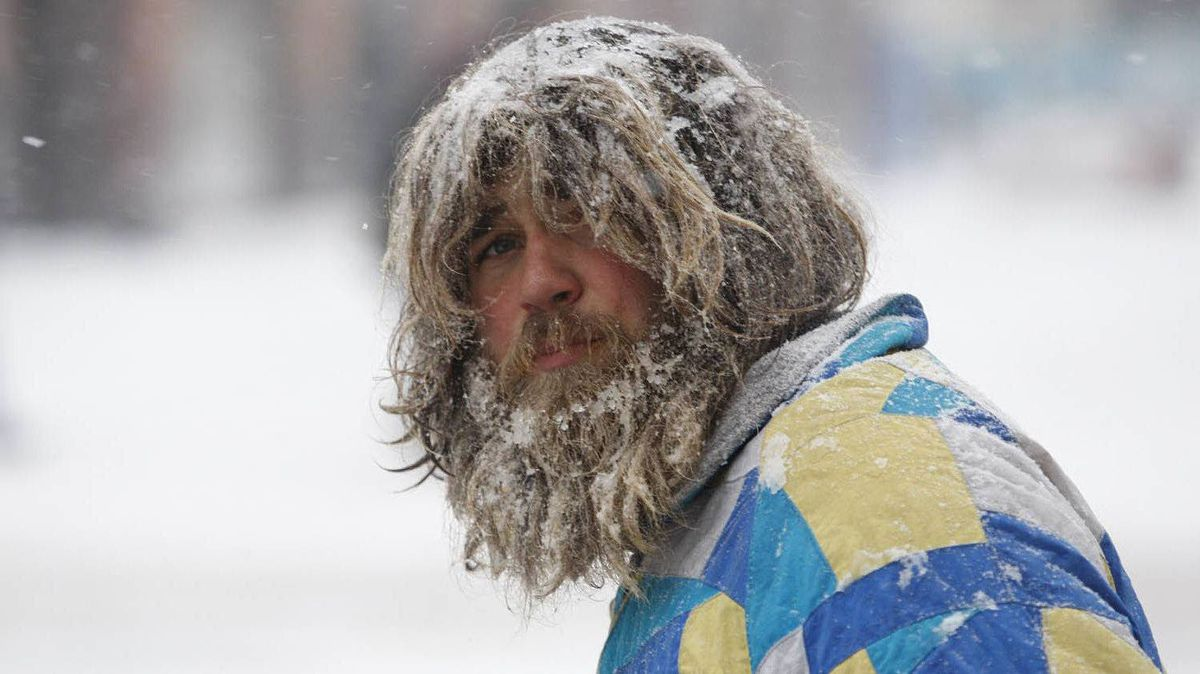 A man is blanketed with snow in downtown Victoria, B.C., on Jan. 18, 2012.
