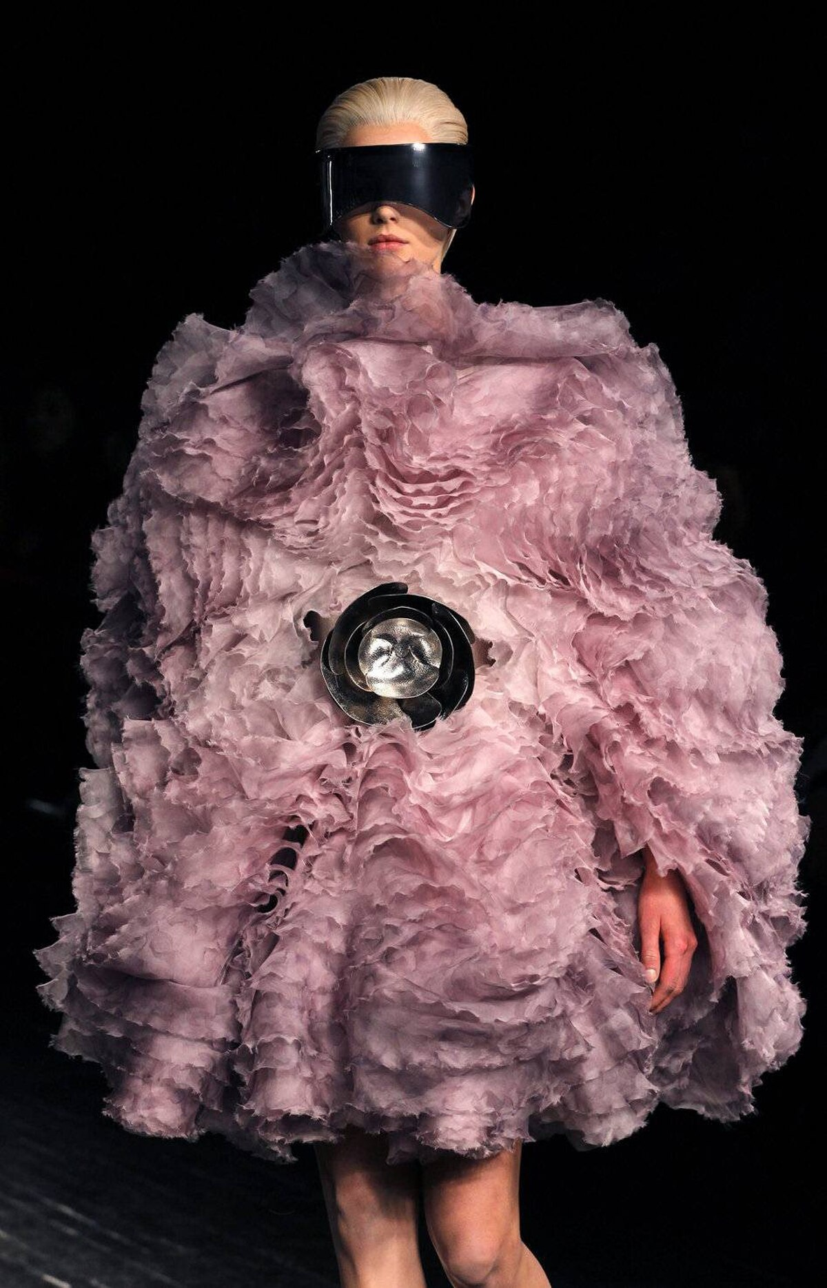 Burton gradually introduced more and more volume, through fur pompoms or feathers. By this point, the creations started to resemble wondrous sea anemones.