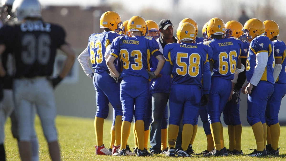 Students at Sir Robert L. Borden high school talk to a coach during a football game against Lester B. Pearson C.I. in Scarborough.