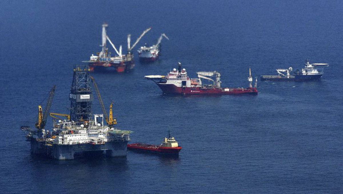 Ships and drilling rigs surround the Discoverer Enterprise as it continues to recover oil from the Deepwater Horizon drill site in the Gulf of Mexico