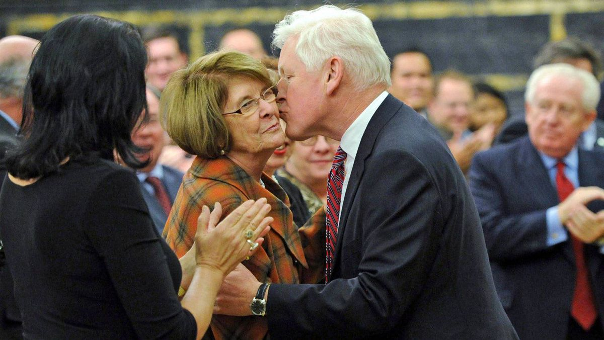 Interim Leader Bob Rae kisses Lise St-Denis, who crossed the floor from the NDP, as he arrives at Liberal Party's winter caucus meeting in Ottawa on Jan. 11, 2012.