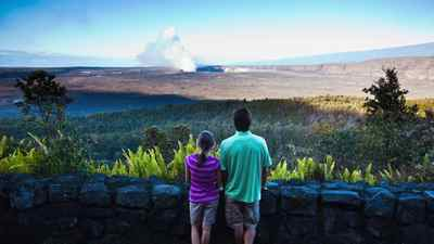 Halemaumau crater smokes in the distance at Hawaii Volcanoes National Park on the Big Island of Hawaii.