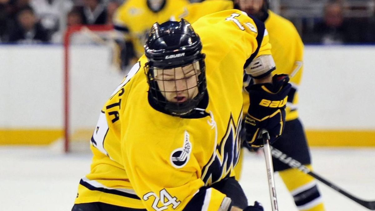 Merrimack forward Stephane Da Costa, right, tries to carry the puck past Notre Dame defenceman Joe Lavin during the first period of a Northeast regional semifinal game in the NCAA college hockey tournament in Manchester, N.H., Saturday, March 26, 2011.