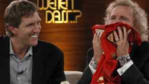 """German TV show host Thomas Gottschalk receives a jersey presented by NBA basketball player Dirk Novitzki (L) of Germany during the German TV game show """"Wetten Dass"""" (Bet it...?) in the southern German town of Friedrichshafen, on December 3, 2011. After some 24 years Gottschalk retired as host of one of the most popular Saturday night programmes in Germany. Getty Images/ ARND WIEGMANN"""