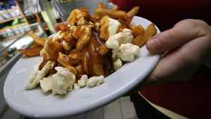 A serving of poutine heads out to a customer at La Formagerie du Village in Warwick, Quebec.