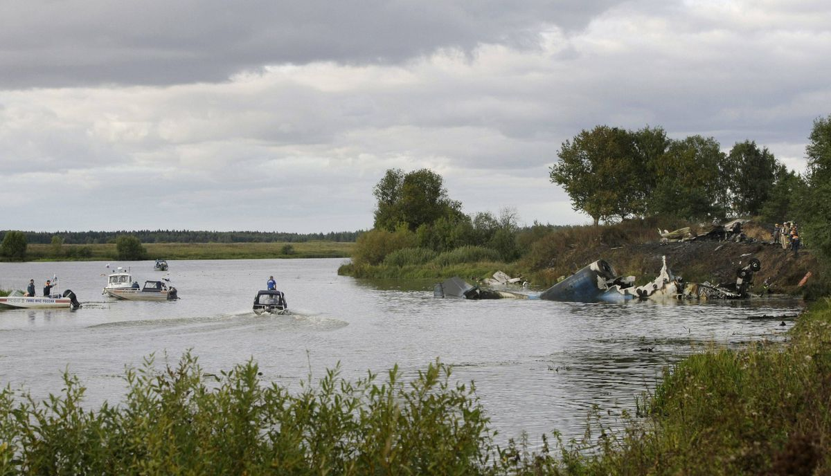Rescuers work at the crash site of Russian Yak-42 jet near the city of Yaroslavl, on the Volga River about 150 miles (240 kilometers) northeast of Moscow, Russia, Wednesday, Sept. 7, 2011.