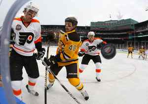 Claude Giroux #28 of the Philadelphia Flyers fights for possession of the puck against Matt Hunwick #48 of the Boston Bruins during the 2010 Bridgestone Winter Classic at Fenway Park on January 1, 2010 in Boston, Massachusetts. The Boston Bruins defeated the Philadelphia Flyers 2-1 in overtime. (Photo by Jim McIsaac/Getty Images)