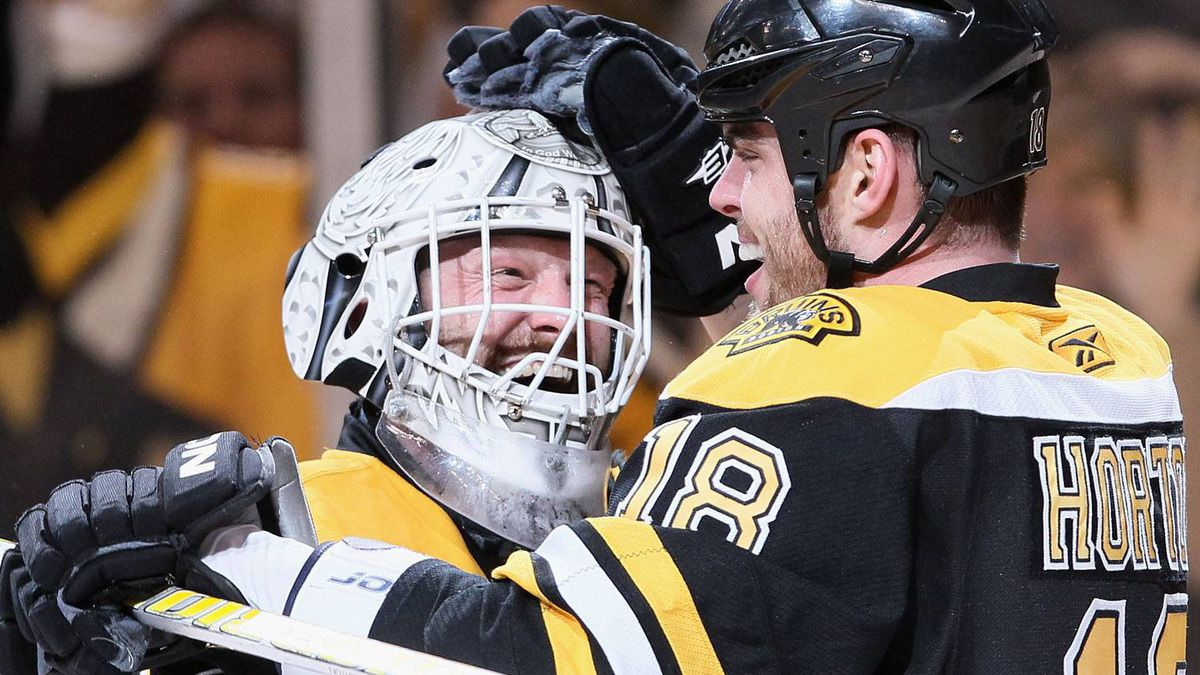 Tim Thomas #30 and Nathan Horton #18 of the Boston Bruins celebrate the win in Game Five of the Eastern Conference Quarterfinals during the 2011 NHL Stanley Cup Playoffs at TD Garden on April 23, 2011 in Boston, Massachusetts. The Boston Bruins defeated the Montreal Canadiens 2-1 in double overtime. (Photo by Elsa/Getty Images)