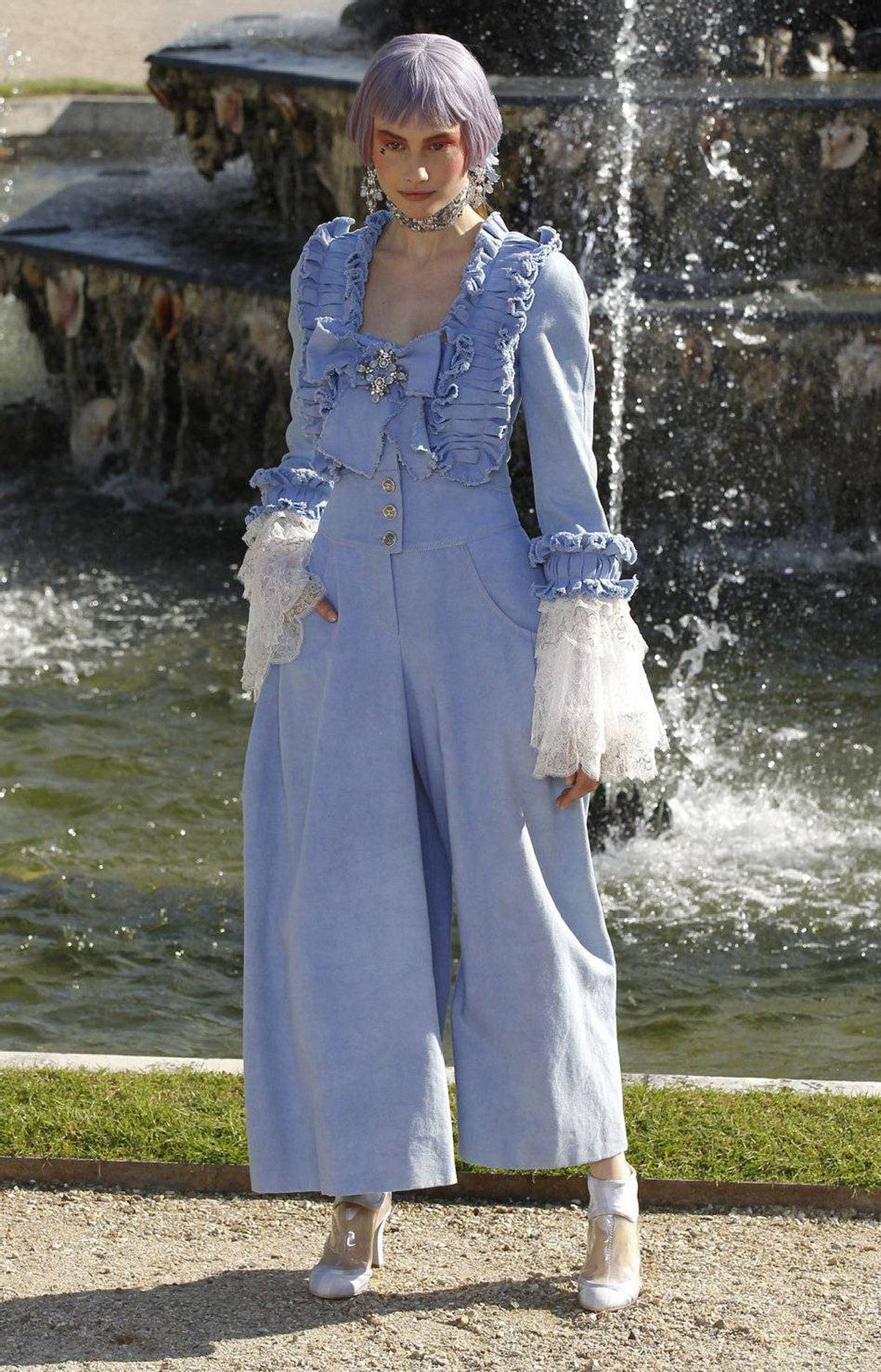With a remix of MIA's Bad Girls blaring through the garden setting, models strolled through the gravel like descendants of Marie Antoinette by way of 1980s SoHo. Here, casual chambray counters the period details. Also, of course, jumpsuits did not exist in the 18th century.