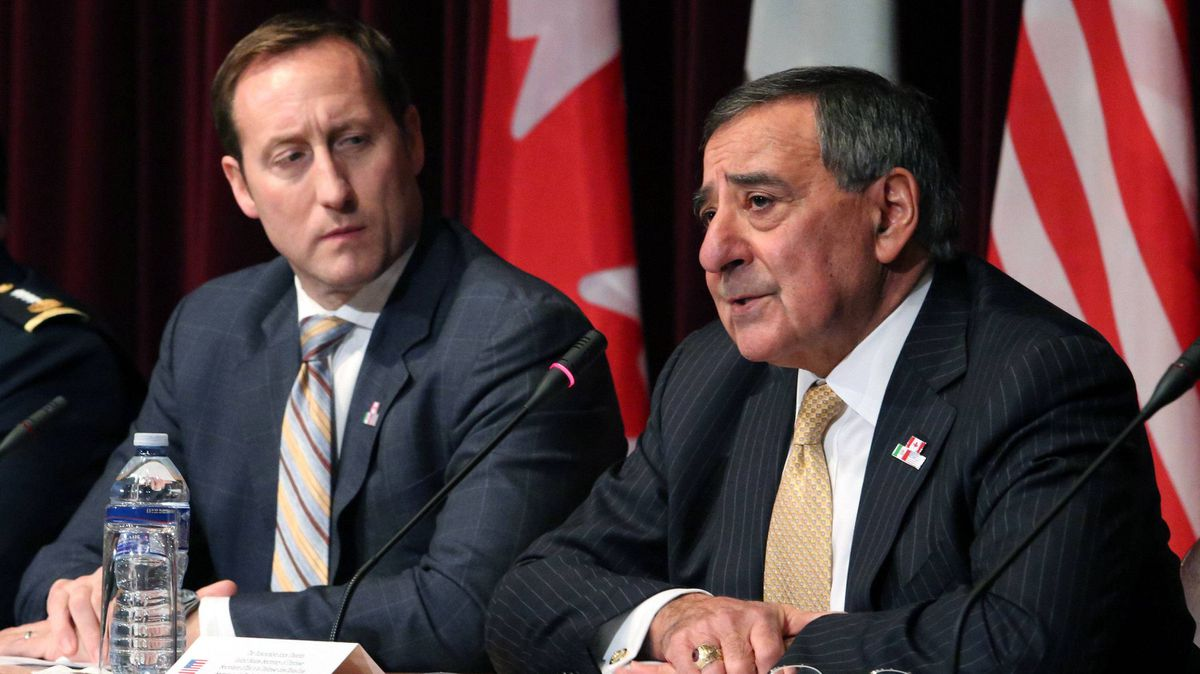 Canadian Defence Minister Peter MacKay, left, listens beside U.S. Secretary of Defence Leon Panetta at a trilateral meeting in Ottawa on Tuesday.