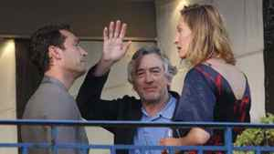 Cannes jury president Robert De Niro waves as he stands on a balcony next to jury members Jude Law and Uma Thurman at the Martinez Hotel in Cannes, on Tuesday.