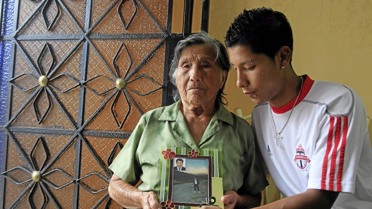 Julia Hernandez and David Blancas, mother and son of victim David Blancas at Julia's home in Comas, Lima, Peru.