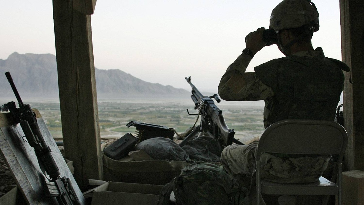 A Canadian soldier scans the horizon while on sentry duty at Ma'sum Ghar camp in Kandahar province, southern Afghanistan, on Oct. 12, 2007.