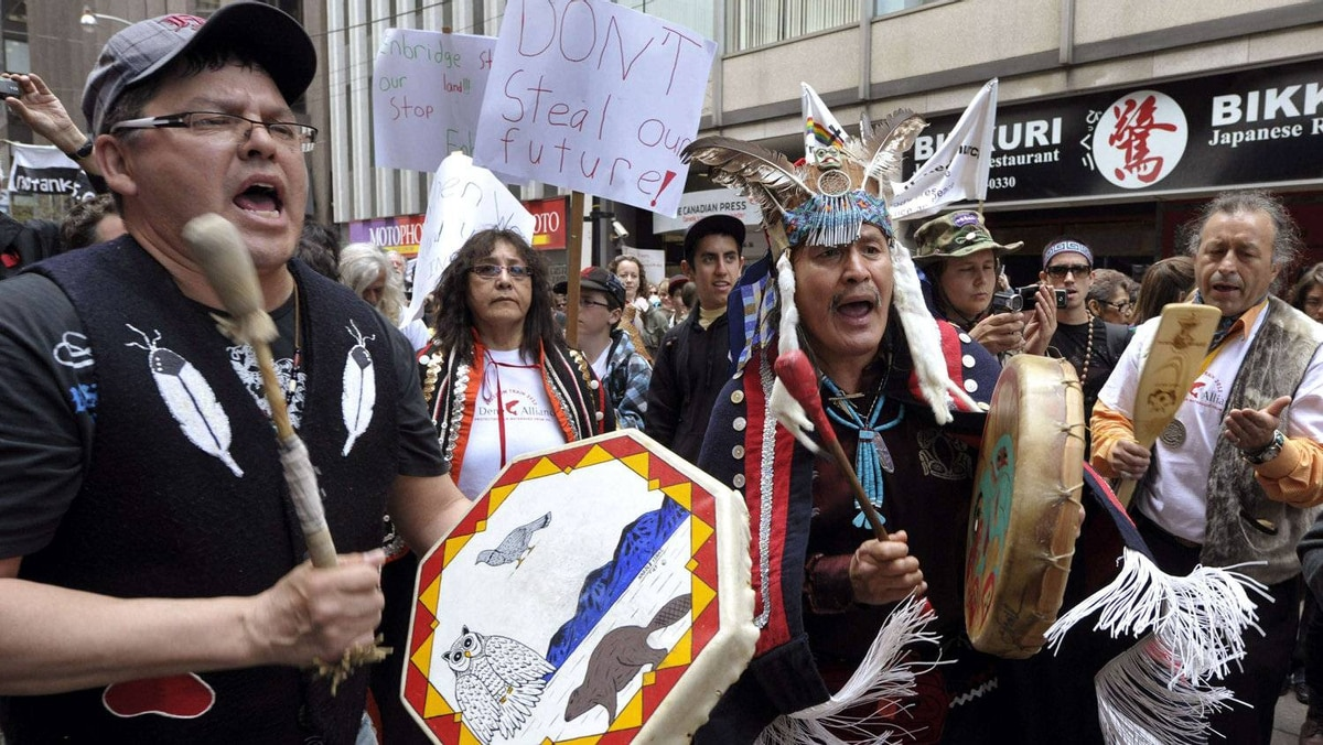 First Nations members protest outside the Enbridge Inc. annual shareholders' meeting in Toronto May 9.