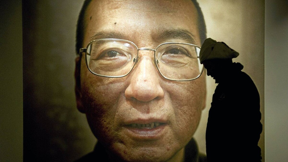 A man walks in front of a poster of Chinese dissident and peace prize laureate Liu Xiaobo at an exhibition at the Nobel Peace Center in Oslo on Dec. 9, 2010.