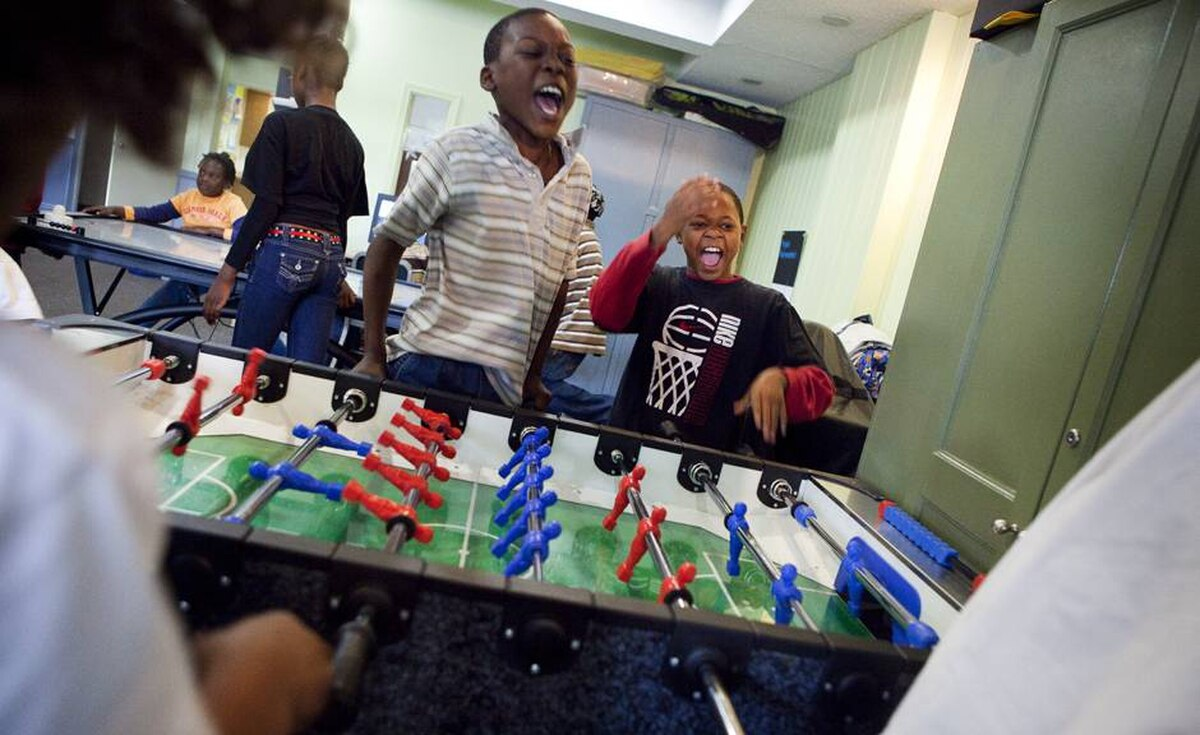 Children play at Frontlines, a Weston Road community drop-in centre funded by private donations.