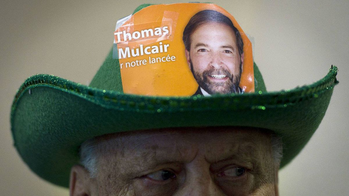 Delegate George Szebik shows his support for Thomas Mulcair at the NDP leadership convention at the Metro Toronto Convention Centre in Toronto, Ont. Saturday, March 24, 2012.