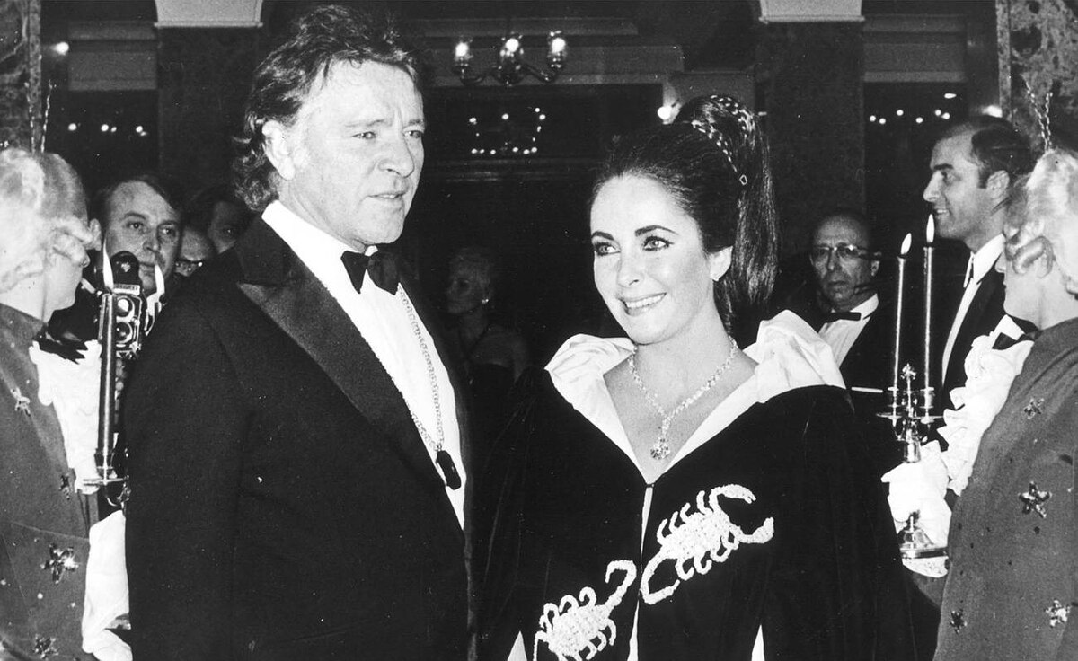 Richard Burton and Elizabeth Taylor, wearing a Cartier diamond of almost 70 carats, arrive at Hotel Hermitage for the Scorpion Ball in Monaco, in this Nov. 15, 1969 file photo.
