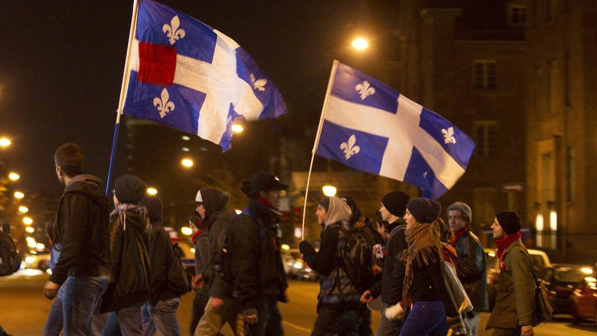 Students hold flags during a march to protest against tuition hikes in downtown Montreal, Quebec April 28, 2012.