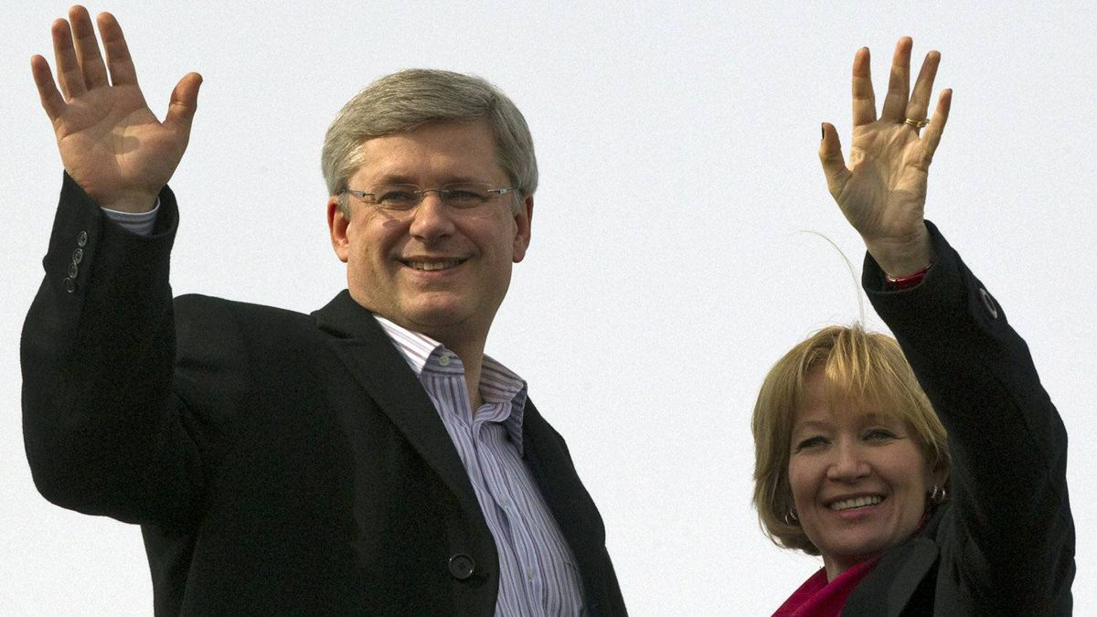 Conservative Leader Stephen Harper and his wife Laureen wave before boarding their campaign plane in Yellowknife on April 18, 2011.