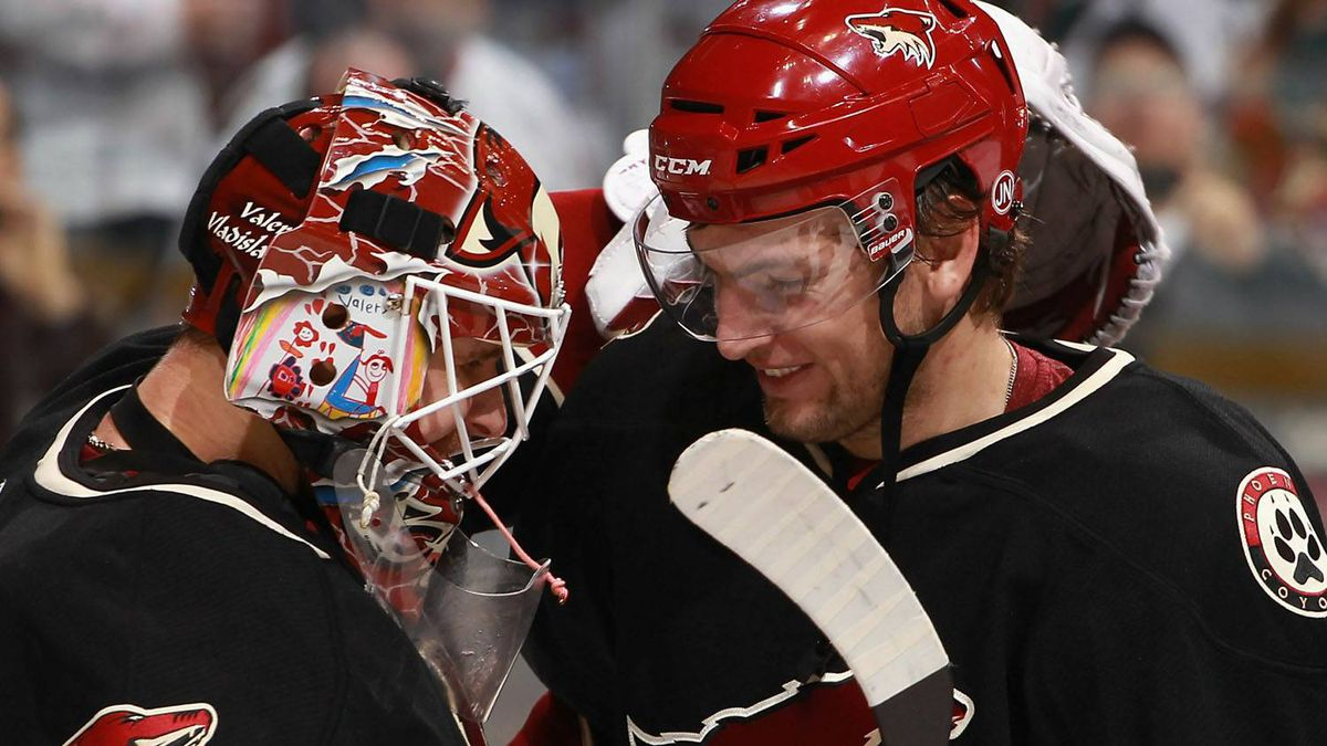 Goaltender Ilya Bryzgalov #30 of the Phoenix Coyotes celebrates with teammate Martin Hanzal #11 after the Coyotes defeated the Edmonton Oilers in the NHL game at Jobing.com Arena on November 23, 2010 in Glendale, Arizona. The Coyotes defeated the Oilers 5-0. (Photo by Christian Petersen/Getty Images)