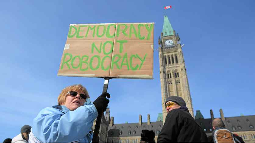 Protesters take part in a robocall protest on Parliament Hills in Ottawa on Monday, March 5, 2012.