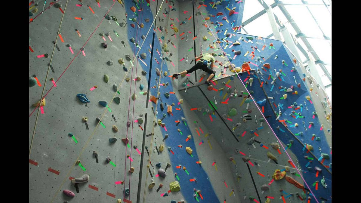 Assistant professor Jill Parnell climbing the rock wall at the REC centre at Mount Royal University in Calgary.