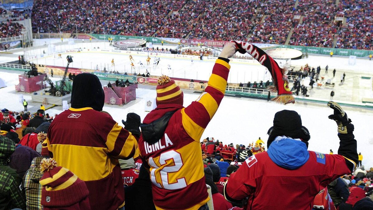 Fans cheer after a Calgary goal during the NHL Heritage Classic, between the Calgary Flames and Montreal Canadiens, in Calgary, Alta., Sunday, Feb. 20, 2011. THE CANADIAN PRESS/Larry Macdougal