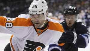 Philadelphia Flyers' Jaromir Jagr (68) battles with Winnipeg Jets' Tobias Enstrom (39) during first period NHL hockey action in Winnipeg, Tuesday, February 21, 2012. THE CANADIAN PRESS/Trevor Hagan