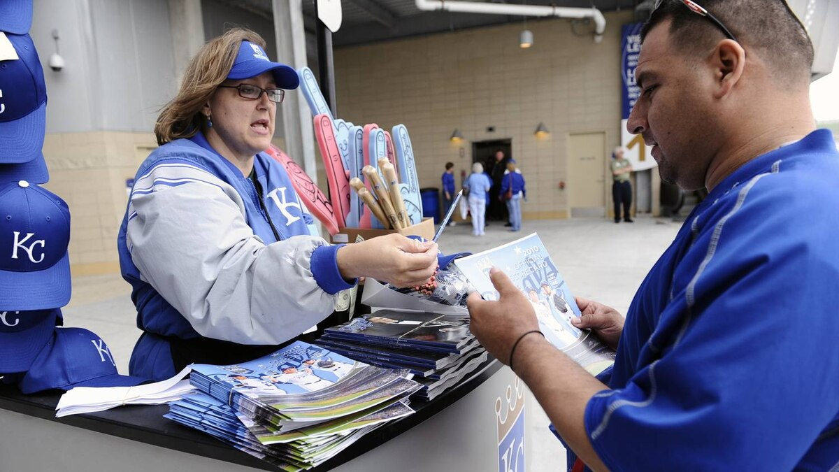 A vendor sells the season-opening program prior to the home opener for the Kansas City Royals against the Detroit Tigers on April 5, 2010 at Kauffman Stadium in Kansas City, Missouri. (Photo by G. Newman Lowrance/Getty Images)