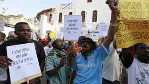 Residents and environmental activists participate in a demonstration against the construction of the proposed Lamu Port-South Sudan-Ethiopia (LAPSSET) project in Lamu island, Kenya, March 1, 2012.