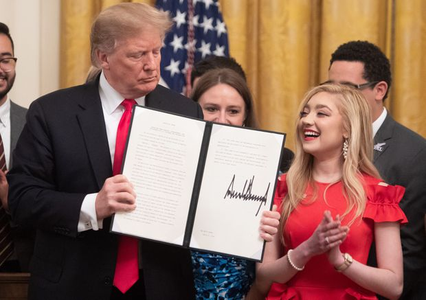 Trump signs order linking funding for public colleges with 'free speech' efforts