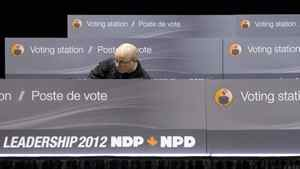 A worker constructs voting stations as the NDP get ready for the party leadership convention in Toronto on Wednesday, March 21, 2012.