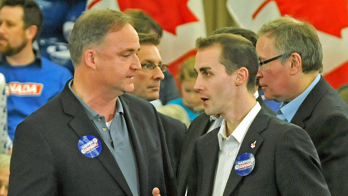 Guelph Conservative candidate Marty Burke, left, chats with his director of communications Michael Sona before the Here for Canada rally April 4, 2011 in Guelph, Ontario.