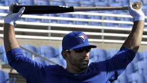 Toronto Blue Jays batter Jose Bautista stretches during batting practice at their MLB American League spring training facility in Dunedin, Florida February 20, 2012. REUTERS/Mike Cassese
