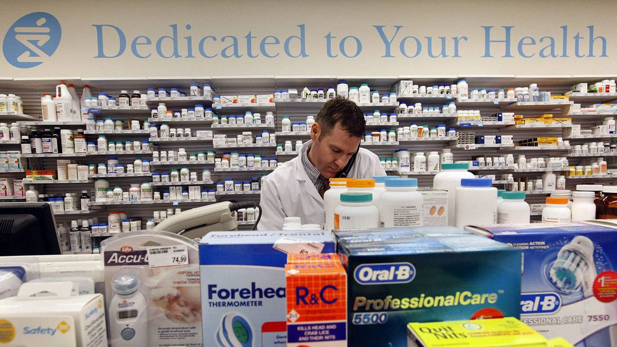 Shoppers Drug Mart pharmacist Barry St. Pierre works in the dispensary at the Prescription Centre at a Shoppers Drug Mart location in Toronto.