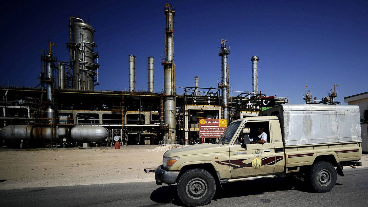Libyan rebels drive past the Zawiya oil refinery on Aug. 19, 2011 after taking control of the facility.