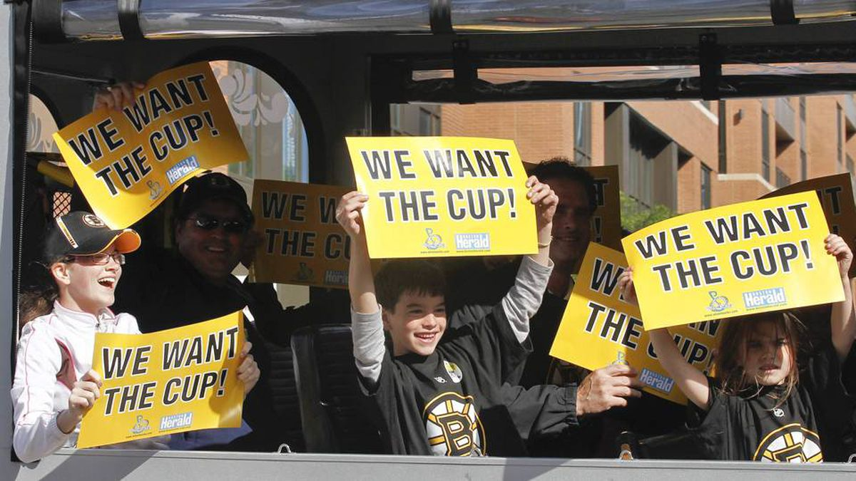 Children riding in a trolley car show their support for the Boston Bruins as they pass the arena before Game 6.
