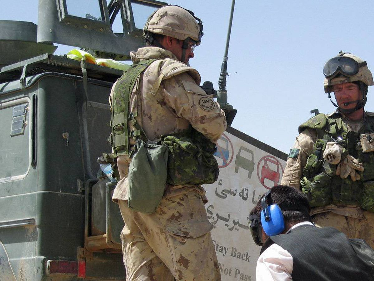 Canadian troops detain an Afghan man during Operation Medusa in the Panjwaii district of Kandahar province on Sept. 5, 2006.