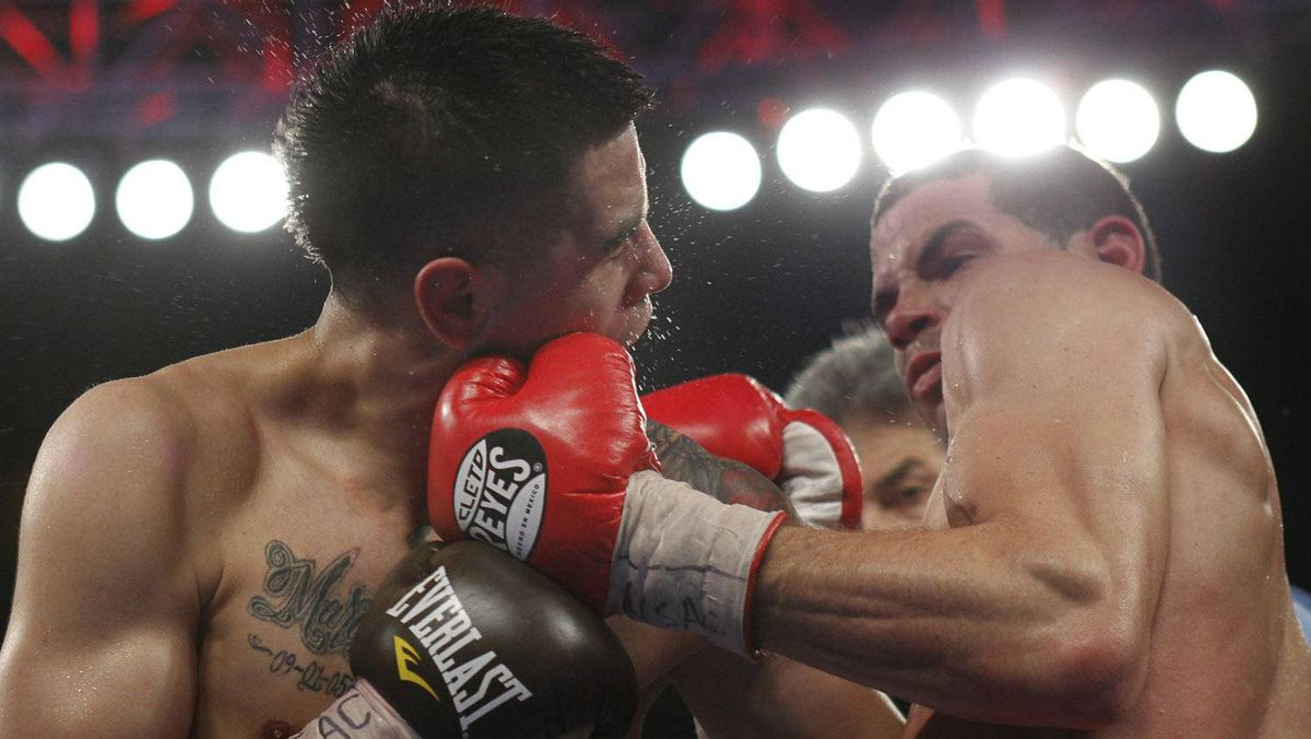 Former lightweight champion boxer Brandon Rios (L) of the U.S. takes a punch from Richard Abril of Cuba during a fight for the vacant WBA lightweight title at the Mandalay Bay Events Center in Las Vegas, Nevada April 14, 2012. Rios won the 12-round fight by split decision but does not receive the title because he was overweight at the official weigh-in. REUTERS/Las Vegas Sun/Steve Marcus