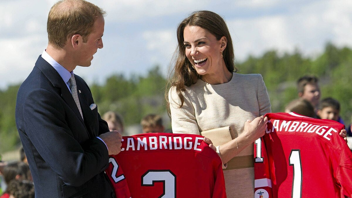 The Duke and Duchess of Cambridge laugh as they receive Team Canada hockey jerseys as they take part in a ball hockey event in Yellowknife, N.T. on Tuesday, July 5, 2011.
