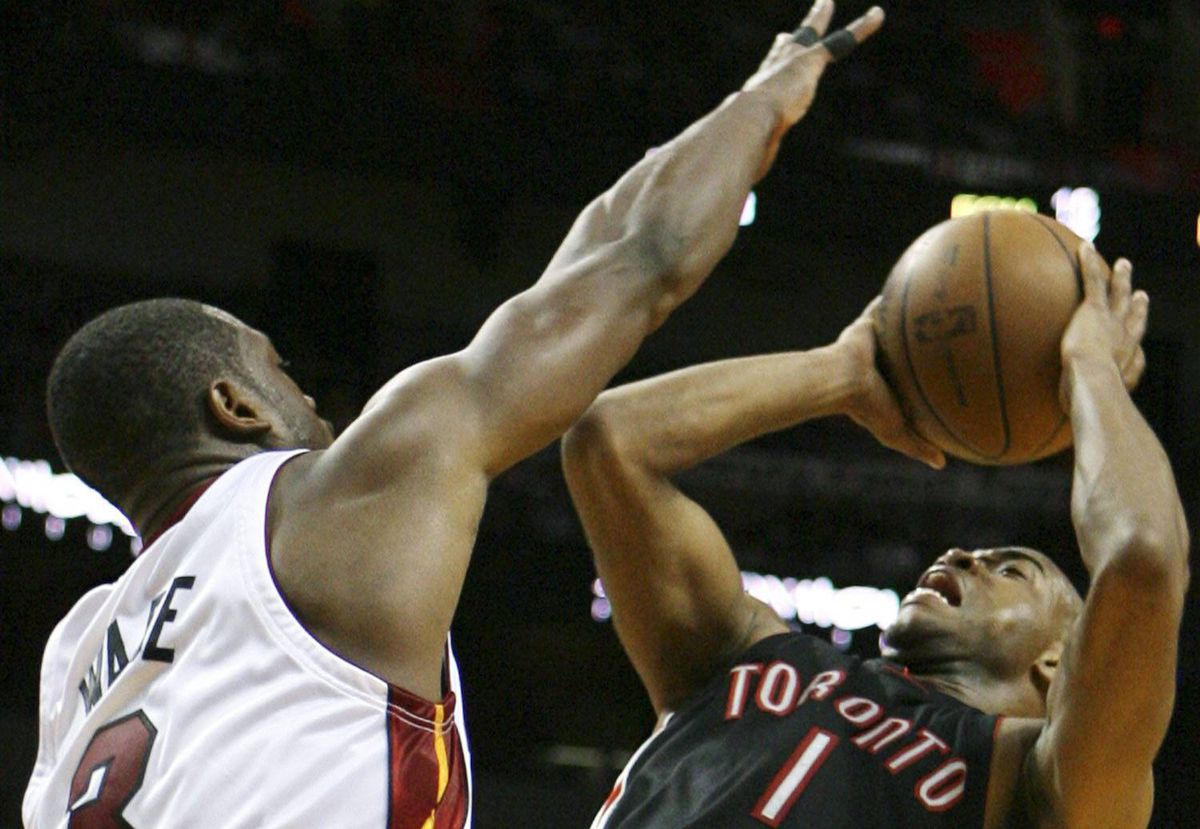 Miami Heat's Dwyane Wade defends as Toronto Raptors' Jarrett Jack shoots during the second quarter of an NBA basketball game in Miami, Sunday, March 28, 2010. (AP Photo/Jeffrey M. Boan)