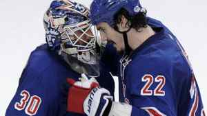 New York Rangers goalie Henrik Lundqvist (L) is congratulated by teammate Brian Boyle after the Rangers defeated the New Jersey Devils in Game 1 of the NHL Eastern Conference Finals hockey playoffs at Madison Square Garden in New York, May 14, 2012. REUTERS/Ray Stubblebine